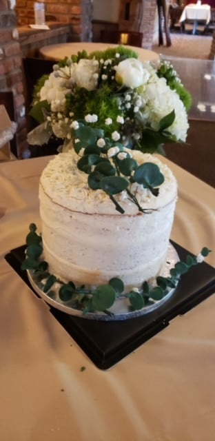 """A  3 layered """"naked"""" cake, delivered to a special bride and groom!  White cake filled with lemon curd and decorated with..."""