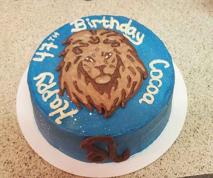 """8"""" Yellow cake with buttercream. Shades of blue, splashes of white and gold shimmer to bring this Leo ♌ cake together.  ..."""