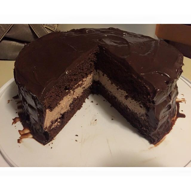 Rich, moist chocolate cake layers filled with thick and fluffy chocolate mousse and iced with creamy chocolate ganache. ...